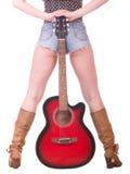 Bei piedini womanish con la chitarra Fotografia Stock