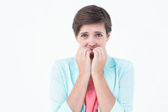 Beißende Nägel des hübschen Brunette mit Angst Lizenzfreies Stockfoto