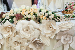 Beig cloth flowers as a part of dinner table decoration Royalty Free Stock Image