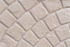 Beiga belagd med tegel trottoartexturbakgrund Arkivbild
