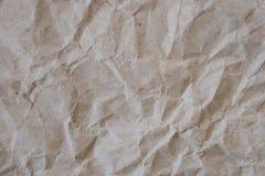 Beiga skrynklade pappers- textur Royaltyfria Bilder
