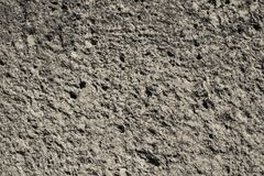 Beige abradant texture of an old stone Royalty Free Stock Photo