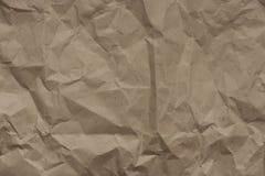Beige achtergrond verfrommeld ambacht verpakkend document, textuur stock afbeeldingen