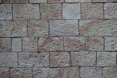 Beige alte Steinziegelsteinwandbeschaffenheit Stockbilder