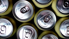 Beige aluminum cans with drinks royalty free stock image