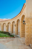 Beige architectural arches in perspective Royalty Free Stock Photography