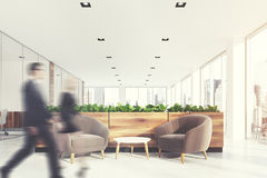 Beige armchairs waiting area, grass, people. Modern office waiting area with beige armchairs, a coffee table, glass wall offices and a flower bed. People. 3d Stock Photography