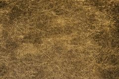 Beige artificial leather texture with stains and veins royalty free stock photos
