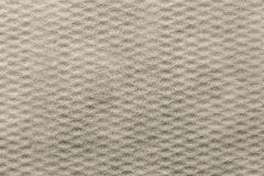 Beige background of corrugated fluffy fabric Stock Image