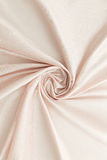 Beige background luxury cloth or wavy folds of grunge silk texture satin velvet. Abstract background luxury cloth or liquid wave or wavy folds of grunge silk Stock Photography