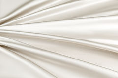 Beige background luxury cloth or wavy folds of grunge silk texture satin velvet Stock Images