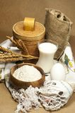 On a beige background, the products are for baking. Flour, egg, wheat ears, milk royalty free stock photo