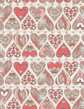 Beige background with red decorative valentine hearts Royalty Free Stock Image