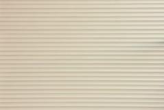 Beige Background of Roller Door Stock Image