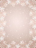 Beige background with snowflakes Stock Photo