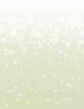 Beige background with snowflakes Stock Images