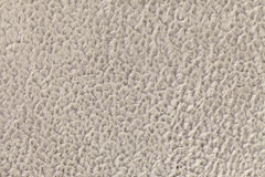 Beige background of soft, fleecy cloth. Texture of textile closeup Royalty Free Stock Photography