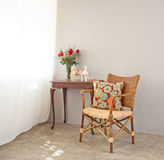 Beige bast chair. With luxurious side table Royalty Free Stock Images
