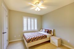 Beige bedroom with kids bed. royalty free stock photography