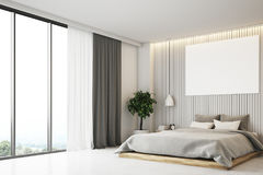 Beige bedroom with a poster, side view Royalty Free Stock Photo