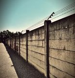 Beige and Black Concrete Wall With Barbwire on Top Stock Images