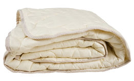 Beige Blanket. Folded beige blanket, isolated on white Royalty Free Stock Image