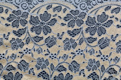 Beige with blue lace. On textural background Royalty Free Stock Photos