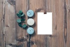 Beige and blue macaroons and blank postcard mockup Stock Images
