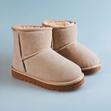 Beige boots. In blue background royalty free stock photography