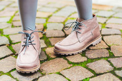 Beige boots on child's feet Royalty Free Stock Photos