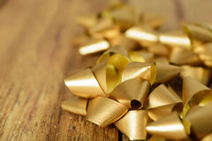 Beige bows on wooden background Stock Photography