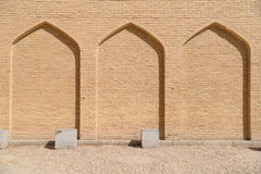 Beige brick wall pattern in arch shape Stock Photos
