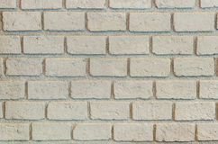 Beige brick wall pattern Stock Images
