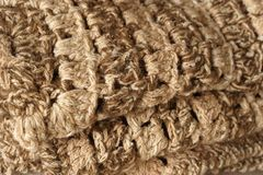 Beige and brown carpet pattern close up. Knitting pattern detailed and structured as background royalty free stock image