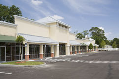 Beige and brown commercial strip mall. Upscale beige strip mall with tin accents and green awnings Royalty Free Stock Images
