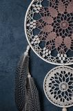 Beige brown dream catcher on black background Royalty Free Stock Photography