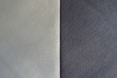Beige and brown fabrics sewn together vertically. Beige and grayish brown fabrics sewn together vertically Stock Photos