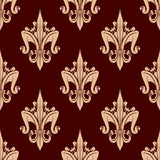 Beige and brown floral seamless pattern. Fleur-de-lis floral seamless pattern with stylized beige lily flowers on brown carmine background. Interior wallpaper Stock Image