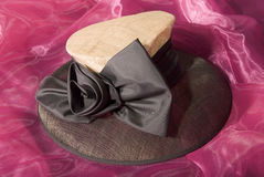 Beige and brown ladies hat. With large ribbon Stock Image
