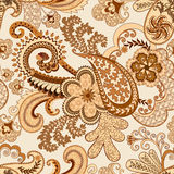 Beige  brown paisley decorated openwork pattern. And flowers on light background Royalty Free Stock Photos