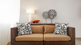 Beige brown sofa in interior setting Royalty Free Stock Photos