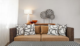 Beige brown sofa in interior setting Royalty Free Stock Photography