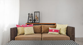 Beige brown sofa in luxurious interior setting Royalty Free Stock Photo