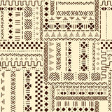 Beige and brown traditional ethnic african mudcloth fabric seamless pattern, vector. Background Royalty Free Stock Photo