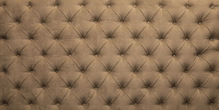 Beige capitone tufted fabric upholstery texture Stock Images