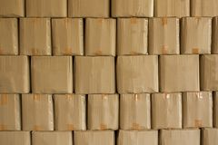 Beige cardboard boxes stand in stack. rough surface texture royalty free stock photography