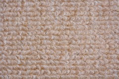 Beige carpet. A close-up photo of a beige carpet Royalty Free Stock Photography