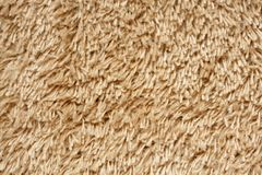 A beige carpet texture Royalty Free Stock Image