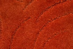 A beige carpet texture. Close-up royalty free stock photography