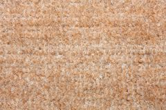 Beige carpet texture. A close up background Stock Photography
